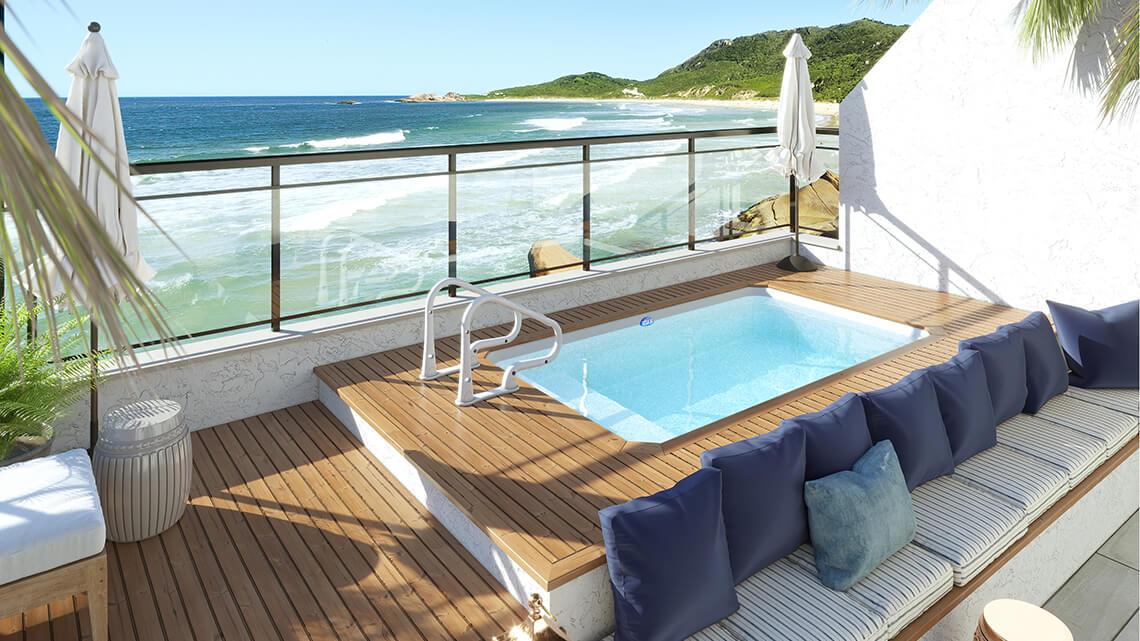 piscina  Naama branca com deck de madeira area lazer